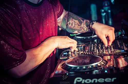 DJ at a gig showing how to secure a DJ residency